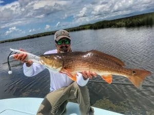 man holding redfish