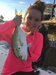 young lady holding small jack crevalle