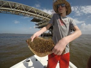 boy holding flounder