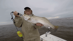 man holding trophy speckled trout
