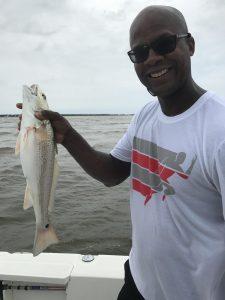 man holding redfish