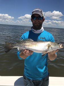 man holding nice speckled trout