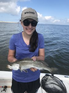 girl holding speckled trout