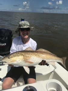boy holding large bull redfish