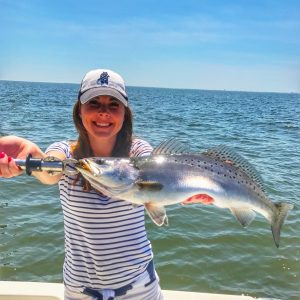 lady holding trophy sized speckled trout
