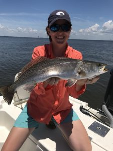 lady holding trophy speckled trout