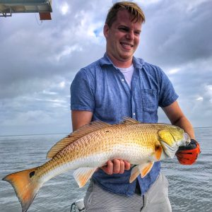 man holding big redfish