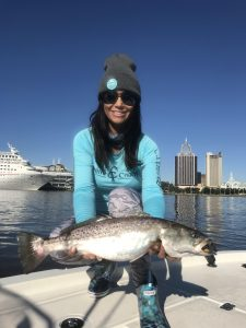 sara maria holding large speckled trout