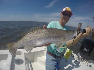 man holding trophy size speckled trout