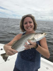 lady holding speckled trout