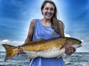 Woman-holding-bull-redfish-on-boat-in-mobile-bay