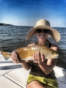 woman-holding-redfish-on-boat-in-mobile-bay