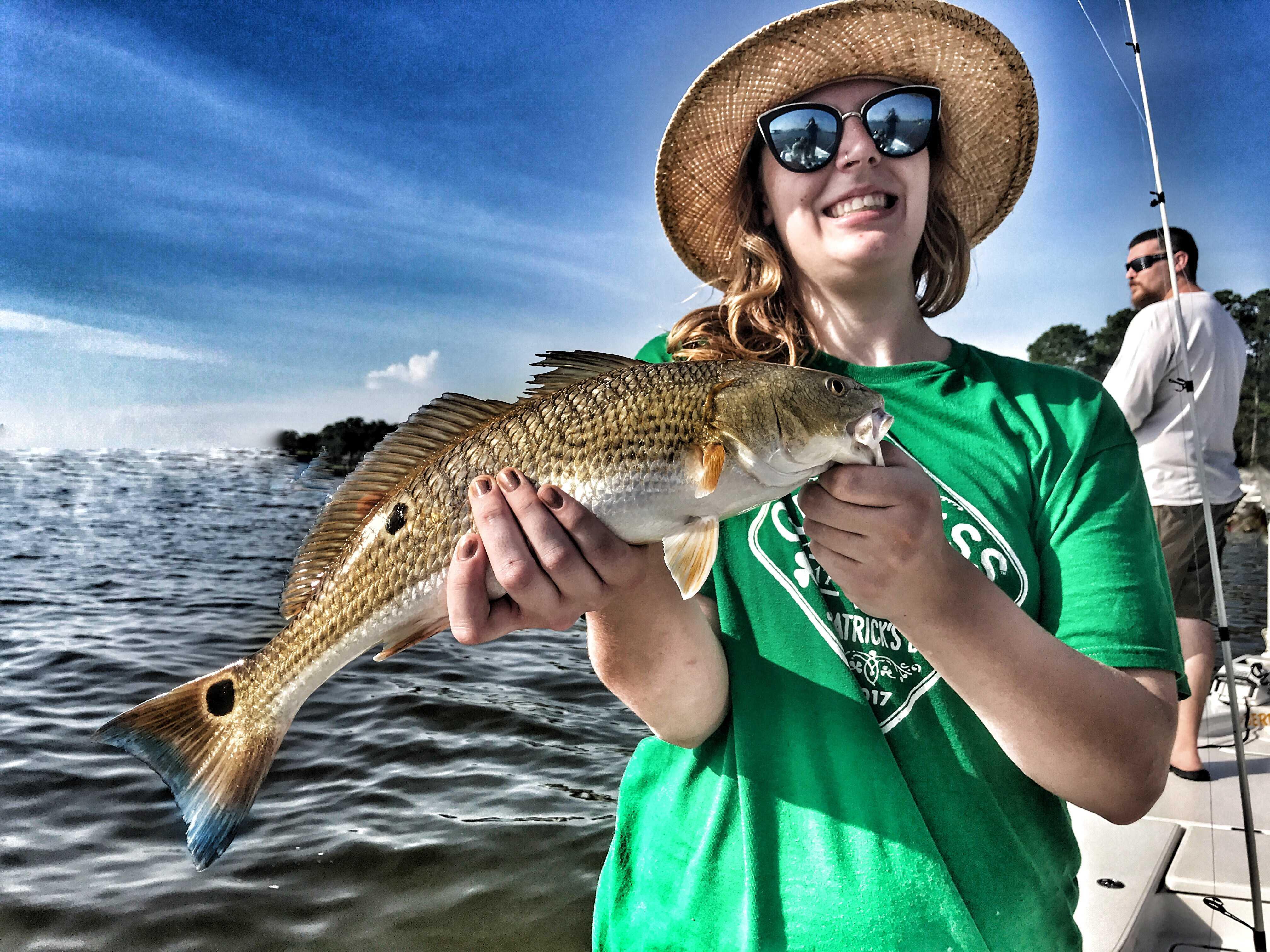 woman-holding-multi-spot-redfish