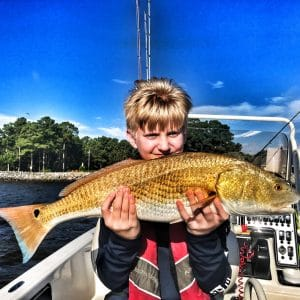 child-holding-large-redfish