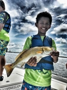 boy-holding-redfish