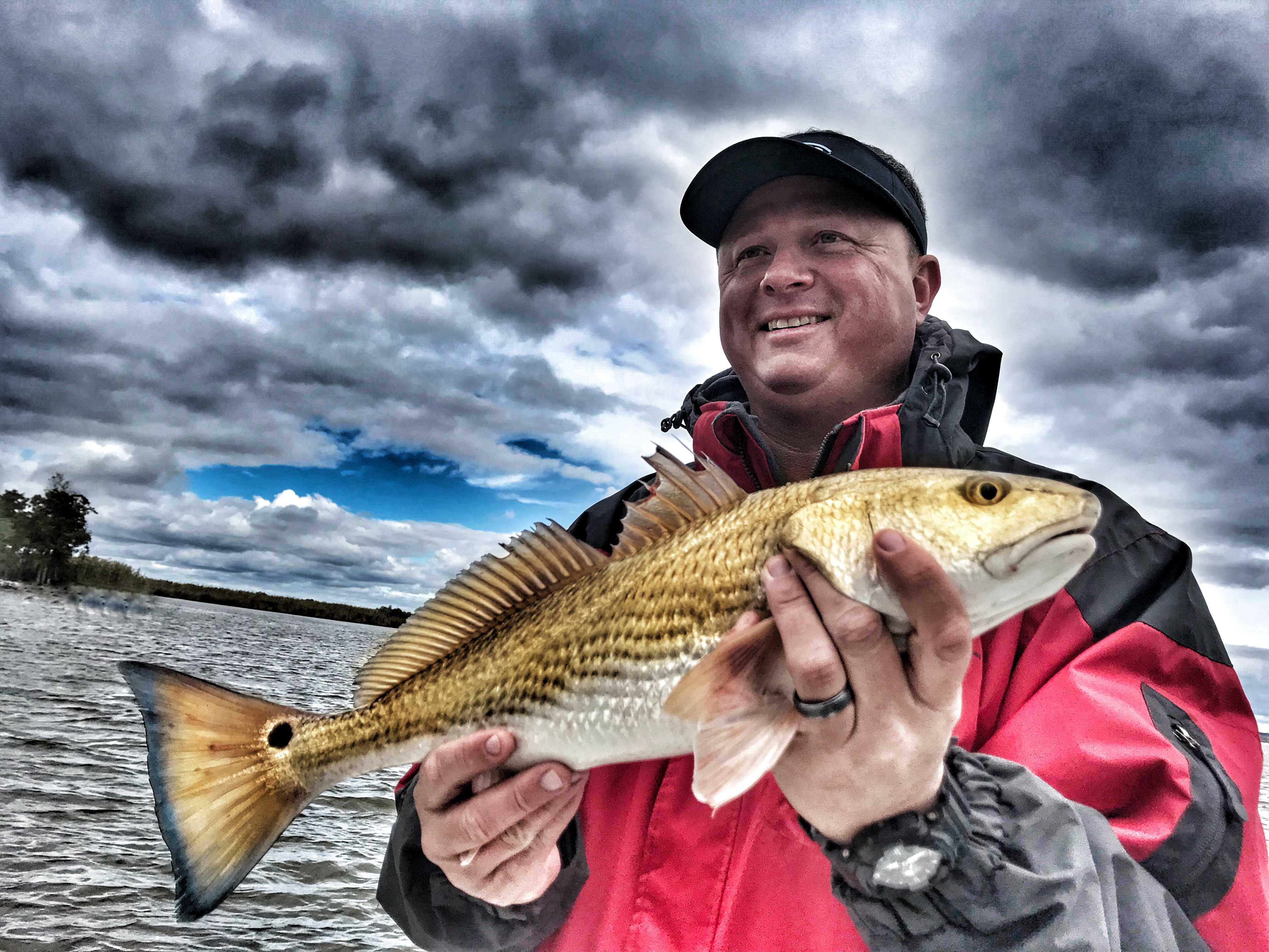 man-holding-redfish