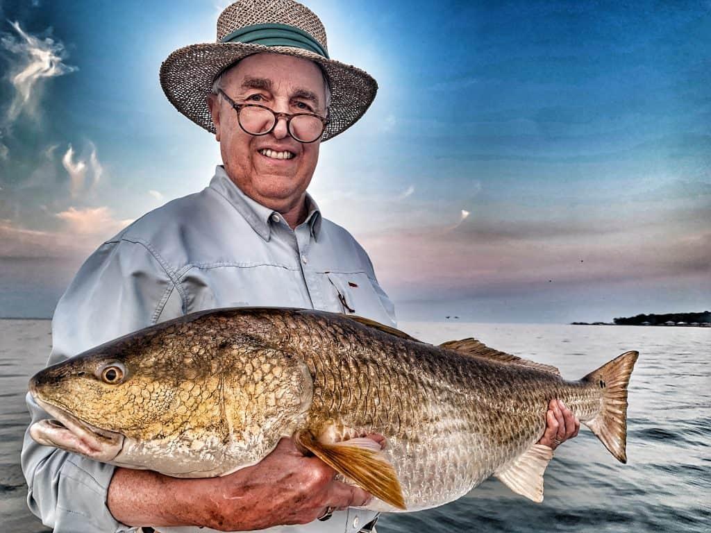 Man holding huge redfish