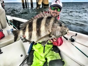 Captain Patric Garmeson holding current alabama state record sheepshead